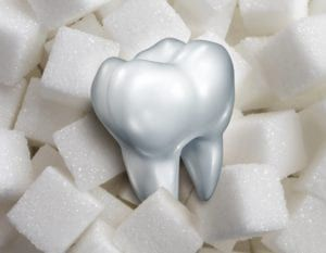 tooth sitting atop sugar cubes